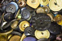 Un mucchio di vecchi bottoni fotografie stock