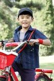 Un muchacho asiático feliz Imagen de archivo libre de regalías