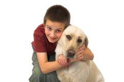 Un muchacho con su perro Imagen de archivo libre de regalías