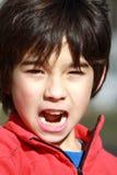 Un muchacho en el ataque Foto de archivo