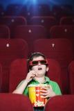 Un muchacho en el cine 3D Fotos de archivo libres de regalías