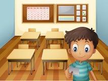 Un muchacho joven dentro de la sala de clase stock de ilustración