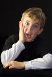 Un muchacho joven emocionado Foto de archivo libre de regalías