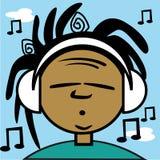 Un muchacho joven que escucha una cierta música Foto de archivo libre de regalías