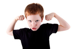 un muchacho lindo muy feliz con sus brazos levantados Imagenes de archivo