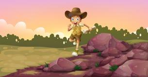 Un muchacho que corre sosteniendo un mapa Fotografía de archivo libre de regalías