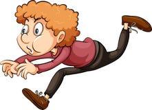 Un muchacho que corre a través del aro Imagen de archivo libre de regalías