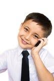 Un muchacho que habla en el teléfono Fotos de archivo