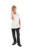 Un muchacho que habla en un teléfono celular Imágenes de archivo libres de regalías