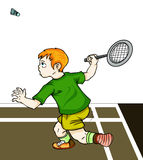 Un muchacho que juega a bádminton Foto de archivo
