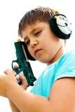 Un muchacho que juega con el arma Imágenes de archivo libres de regalías