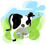 Un muchacho que ordeña una vaca Imagen de archivo libre de regalías