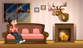 Un muchacho que se sienta en el sofá cerca de la chimenea ilustración del vector
