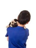 Un muchacho que sostiene su perro Imágenes de archivo libres de regalías