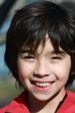 Un muchacho smiing Imágenes de archivo libres de regalías