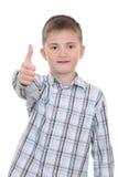 Un muchacho sonriente con la muestra aceptable Fotografía de archivo libre de regalías