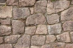 Un mur accumulé avec des pierres Image libre de droits
