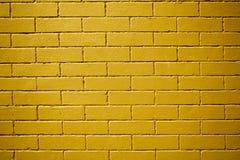 Un mur de briques lisse jaune Surface approximative Texture concrète photographie stock libre de droits
