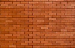Un mur de briques rouge-orange Photographie stock