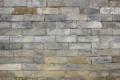 Un mur lisse des briques de marbre Texture en pierre Mur en pierre gris images stock