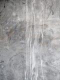 Un mur renversé de stuc souillé par peinture Photographie stock