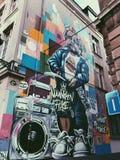 Un mural de Manneken Pis foto de archivo