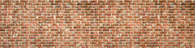 Un muro di mattoni rosso rustico Immagine Stock
