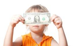 Un niño con un billete de dólar Fotografía de archivo