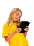 Un niño con un e-libro Imagen de archivo libre de regalías