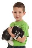 Preschooler con su conejito Imágenes de archivo libres de regalías