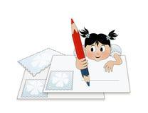 Un niño que escribe una letra (a santa) Fotografía de archivo libre de regalías