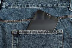 Un noir amincit le téléphone Image stock