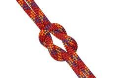 Un nudo con la cuerda roja imágenes de archivo libres de regalías