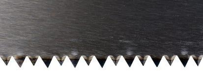 Un nuovo primo piano affilato della sega di legno immagini stock libere da diritti
