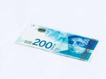 Un nuovo tipo di banconota degno 200 shekel israeliani isolati su un fondo bianco Fotografia Stock