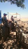 UN Observers - Mount Bental, Golan Heights. Two United Nations Disengagement Observer Force (UNDOF) soldiers from Norway observing (with binoculars) the border Royalty Free Stock Photos