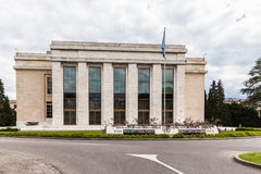 UN office building in Geneva. Geneva, Switzerland - August 23, 2014 - Office building of the United Nations at Geneva (UNOG) wtih the flag of UN in front. Photo Stock Photo