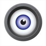 Un ojo dentro de la lente de cámara Foto de archivo