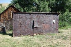 Un ol, casa del goldrush hecha con latas de la galleta en Idaho Foto de archivo libre de regalías