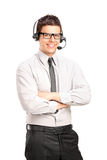 Un operador de sexo masculino del servicio de atención al cliente que desgasta un receptor de cabeza Imagen de archivo