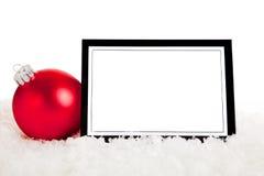 Un ornamento rojo con notecard en blanco Imágenes de archivo libres de regalías