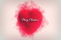 Un ornement rouge décoratif de coeur pour le tre de Noël ou de nouvelle année Image libre de droits