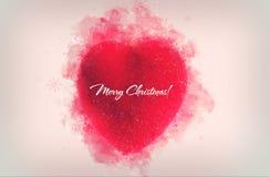 Un ornement rouge décoratif de coeur pour le tre de Noël ou de nouvelle année Photo libre de droits