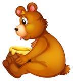 Un oso con un pote de miel Foto de archivo libre de regalías