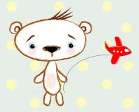 Un oso dulce del muchacho muestra apagado su plano-trama Fotografía de archivo
