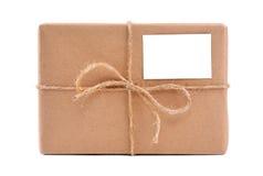 Un pacchetto spostato in documento marrone Fotografia Stock Libera da Diritti