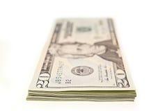 Un pacco di venti banconote in dollari Immagini Stock