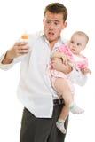 Un padre joven con un bebé Imagen de archivo