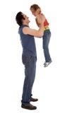 Un padre joven que juega con su hija fotografía de archivo