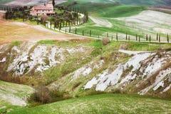 Un paesaggio con la casa nel fondo Fotografia Stock
